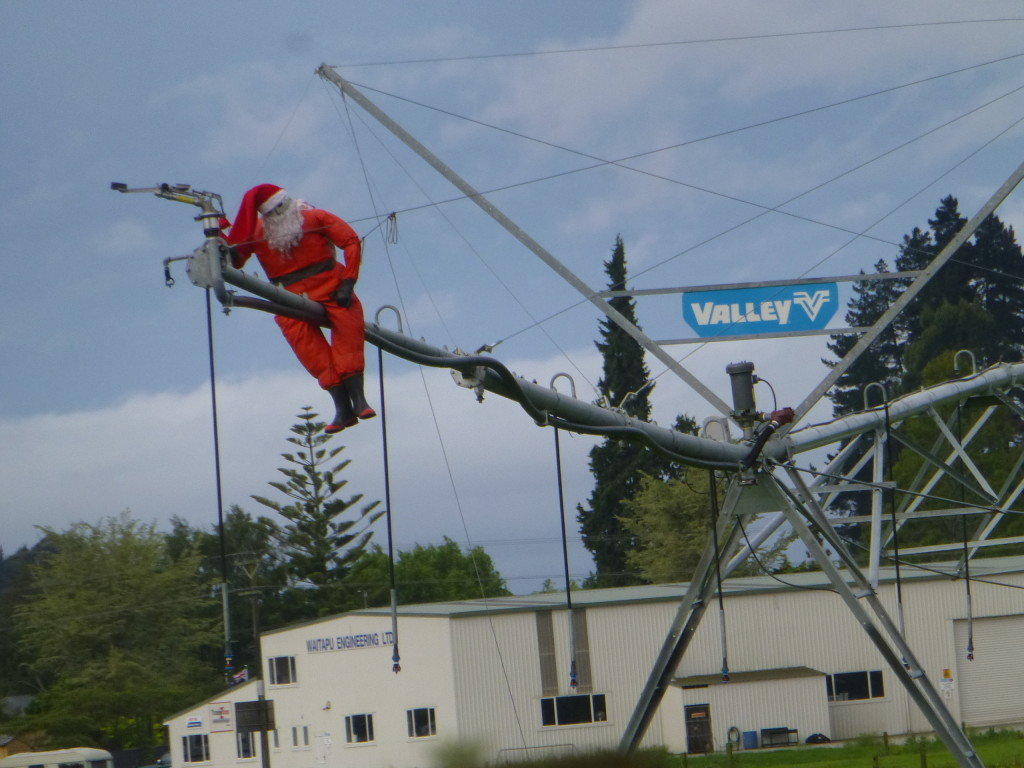 Santa Clause Riding an Irrigation Line